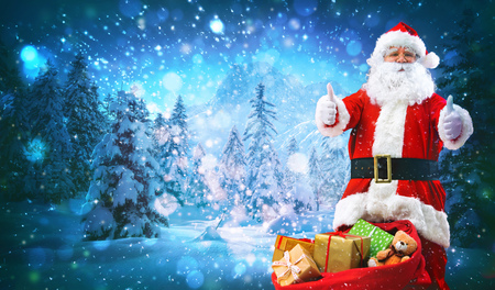 Santa Claus with a bag full of presents shows thumbs up
