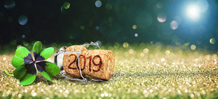Happy New Year. Greeting card with four leaf clover and champagne cork Foto de archivo - 112560195