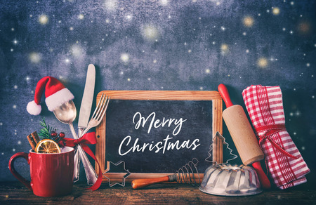 Rustic background for Christmas baking or cooking with kitchen utensils Foto de archivo - 112560198