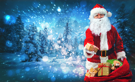 Santa Claus with a bag full of presents on blue snowy background with magical stars