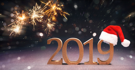 Happy New Year 2019 with Santa hat and fireworks Standard-Bild - 113928805