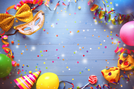 Colorful carnival or birthday  with party items on blue Фото со стока