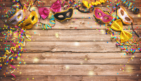 Colorful carnival or birthday  with masquerade masks on wooden