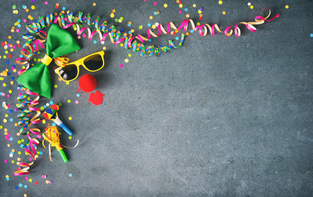 Colorful carnival, festival or birthday  with masks, streamers, candy, confetti and other party items