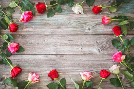 Roses on wooden board. Фото со стока