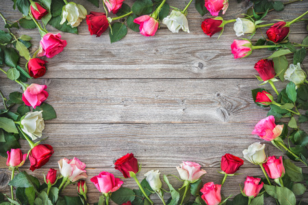Roses on wooden board. Valentines Day Фото со стока