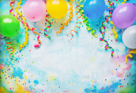 Festival, carnival or birthday party frame with balloons, streamers and confetti on colorful  with copy space Фото со стока