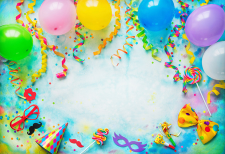 Balloons, present or gift box, confetti, candy, bow tie, sunglasses and streamers on colorful  with copy space. Фото со стока