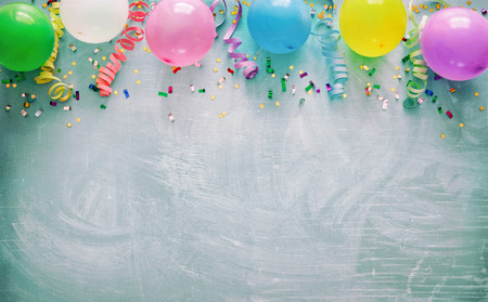 Birthday party decoration with balloons, steamers and confetti
