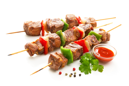 Kebabs - grilled meat and vegetables on skewers. Isolated on white Archivio Fotografico - 120788056