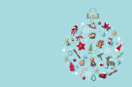 Christmas holiday with objects in bauble ornament shape, top view.