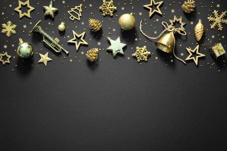 Christmas golden decoration on dark