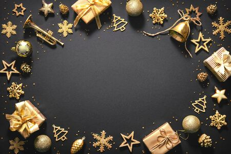 Christmas golden decoration with gift boxes on dark