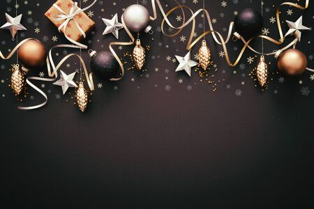 Christmas golden decoration with gift boxes on dark Stock Photo - 133760141