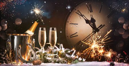 New Years Eve celebration with fireworks and champagne at midnight
