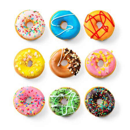 Various colourful donuts isolated on white background