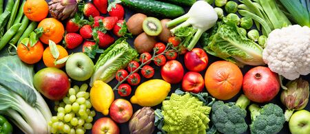 Panoramic food with assortment of fresh organic fruits and vegetables