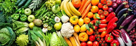 Panoramic food with assortment of fresh organic fruits and vegetables in rainbow colors Stock Photo