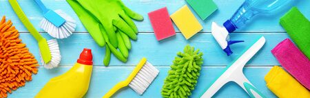 Colorfull cleaning items on blue wooden planks 스톡 콘텐츠