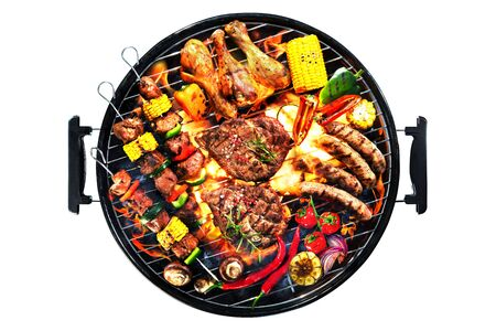 Assorted delicious grilled meat with vegetables on barbecue grill with smoke and flames isolated on white