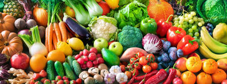 Panoramic food background with assortment of fresh organic fruits and vegetables for a balanced diet. Healthy food concept