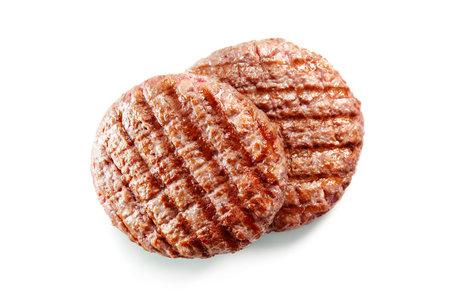 Freshly grilled hamburger patties isolated on white background