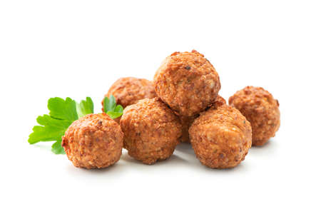 Fried meatballs with a parsley leaf isolated on white background Reklamní fotografie