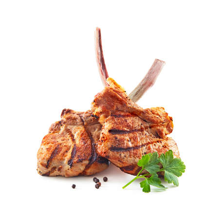 Grilled veal meat ribs cutlets with ingredients isolated on white background. Frenched Racks meat