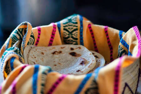 Traditional corn tortilla made by hand in a basket from Guatemala and Central America Stock Photo