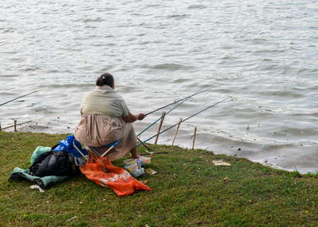 Women fishing on polluted lake in Pampulha, Belo Horizonte, Brazil Editorial