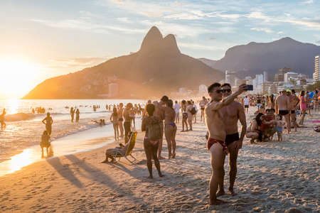 Attractive men take a selfie in Ipanema Beach, Rio de Janeiro at Editorial