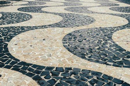 Hyponotic winding design of Pedras Portuguesas , popular in ex-Portuguese colony countries and in Portugal Banco de Imagens - 92645675