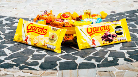 Illustrative editorial of a popular Brazilian assortment of chocolates called Garoto which means boy in Portuguese Editorial