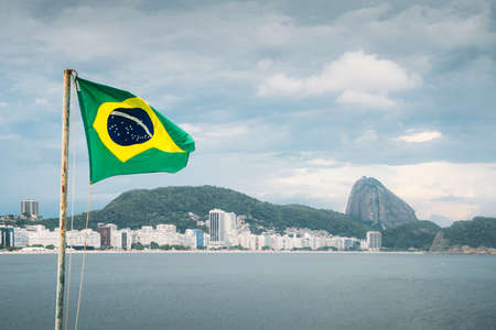 Brazilian flag waving in Copacabana, Brazil