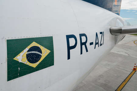 Close up for a Brazilian flag and airplaner identifer on an airplanet parked at Rio de Janeiros Santos Dumont airport