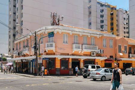 Streetcorner with colonial style architecture in busy Copacabana Editorial