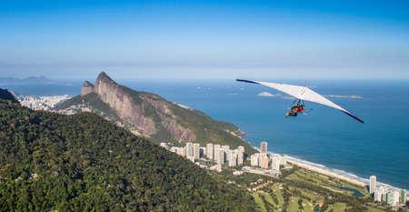 Hang gliding off Pedra Bonita in Sao Conrado, Rio de Janeiro, Brazil Фото со стока