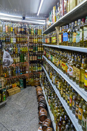 Belo Horizonte, Brazil - Dec 23, 2017: Rows of different types fo cachaca drink, made from distilled rum, for sale at the Mercado Central in Belo Horizonte