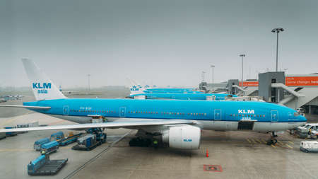 KLM airplanes on tarmac at Schiphol Airport in Amsterdam Редакционное