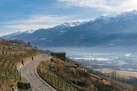 Swerving roads in Valtellina, a valley near Sondrio in the Lombardy region of northern Italy, bordering Switzerland Stock Photo