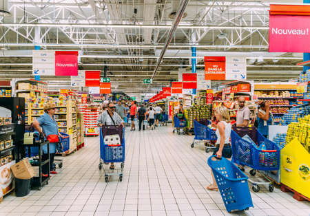 Juan les Pins, August 27, 2017: Shoppers in a Carrefour supermarket in Antibes, France Editorial