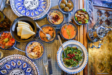 Middle eastern or arabic dishes and assorted meze, concrete rustic background