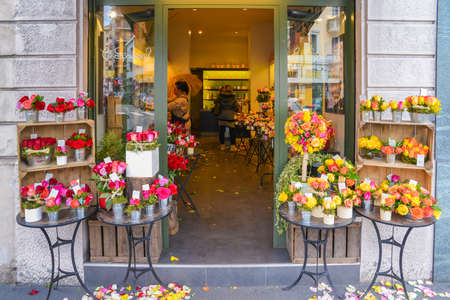 View outside of a shop while assistants arrange flowers at a specialist florist in Milan, Italy Editöryel