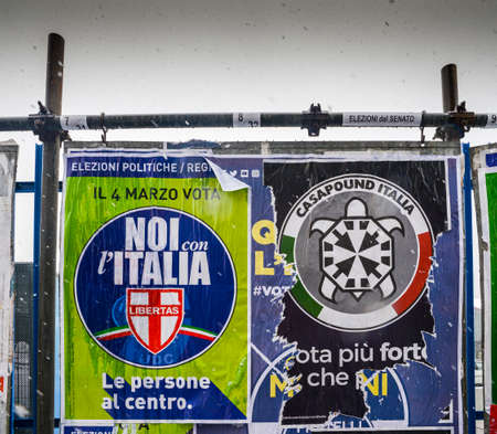 Election posters on billboard ahead of Italian General Election to be held on March 4th, 2018 - CasaPound Italy is a neo-fascist political Party next to moderate Libertas