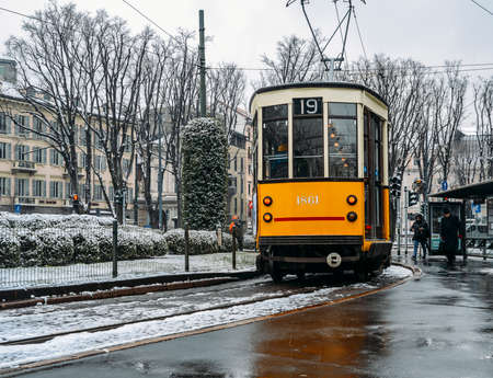 Old Style 1920s tram under the snow in the city of Milan, Italy