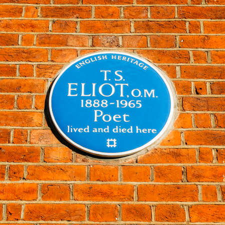 English Heritage blue plague of where the famous poet T.S Eliot lived and died, 1888-1965 in a flat in Kensington, London, England, UK