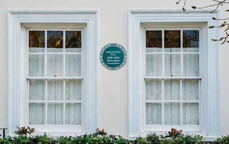 English Heritage blue plague of where the famous philosopher, John Stuart Mill, 1806-1873, lived in a flat in Kensington, London, England, UK