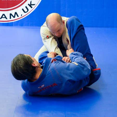 Brazilian Jiu Jitsu mixed martial arts grappling training at Fulham Gracie Barra academy in London, UK 에디토리얼