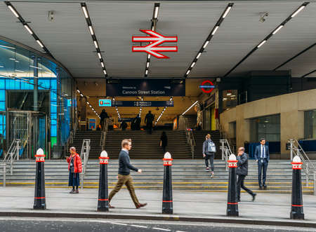 Entrance of Cannon Street Station with City workers. It is situated within fare zone 1 and is one of 19 stations in the United Kingdom managed by Network Rail