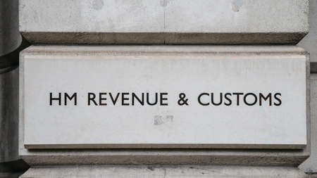 HM Revenue and Customs sign on a building in Whitehall, London, England, UK.